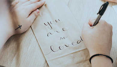 you are loved written on cloth