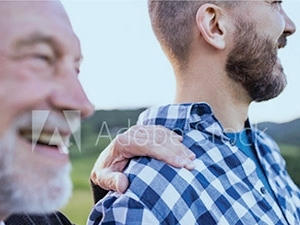 older man smiling with other man